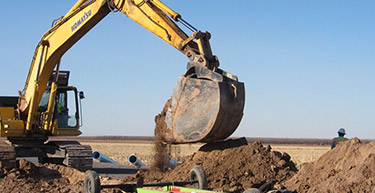 Excavator Bucket Digging a trench | Municipal Water Systems