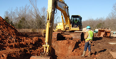 Excavator digging a large hole | Municipal Sewer Systems