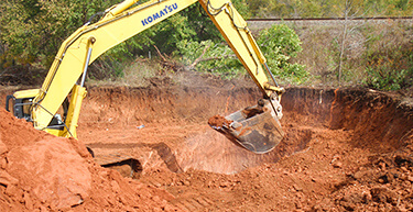 Excavator digging a large area | Storm Water Systems