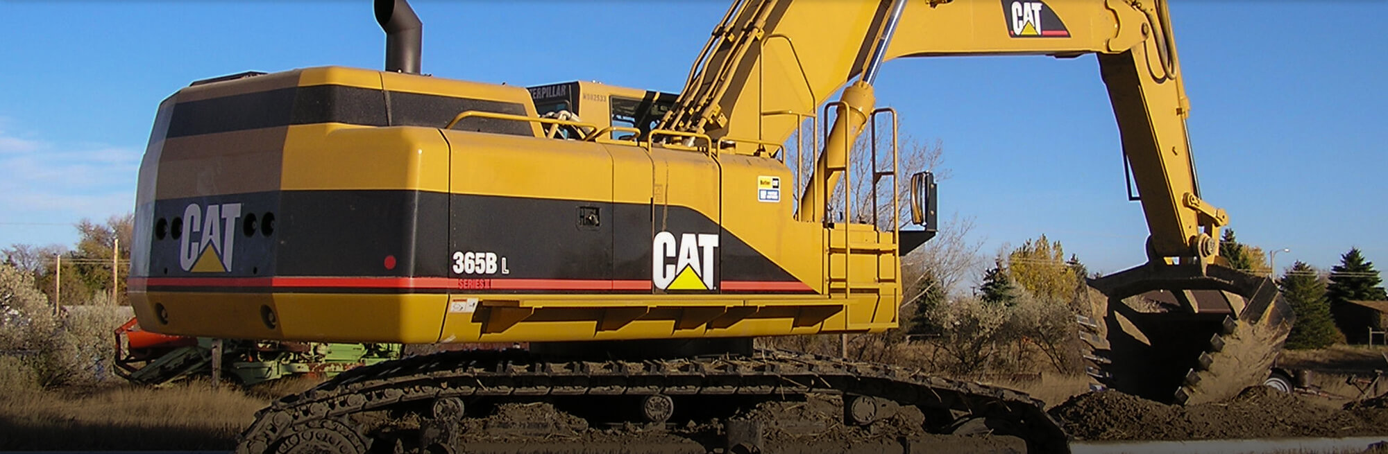 Large 365B CAT excavator at a rural jobsite